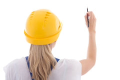 Back view of woman in blue builder uniform writing something on Royalty Free Stock Photos
