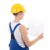 Back view of woman builder in blue coveralls with scheme isolate Stock Image