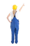 Back view of woman in builder uniform pointing at something isol Stock Image