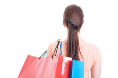 Back view of woman carrying shopping bags on shoulder Royalty Free Stock Image