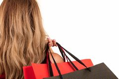 Back view of woman carrying shopping bags on shoulder isolated on white background with text area Stock Images