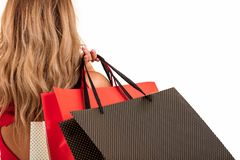 Back view of woman carrying shopping bags on shoulder isolated on white background with text area Royalty Free Stock Image
