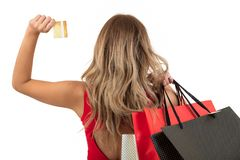 Back view of woman carrying shopping bags on shoulder isolated on white background with text area Stock Photos