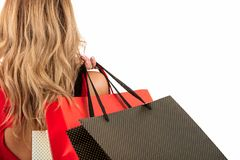 Back view of woman carrying shopping bags on shoulder isolated on white background with text area Stock Photo