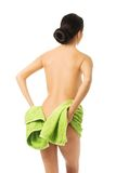 Back view woman covering her bum with a towel Royalty Free Stock Photo