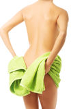 Back view woman covering her bum with a towel Royalty Free Stock Photos