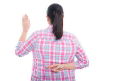 Back view of woman with crossed fingers Royalty Free Stock Images