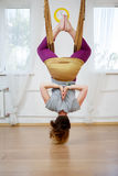 Back view of woman doing yoga in hammock otdoor Royalty Free Stock Images