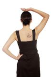 Back view of a woman in dress with coffee tattoo Royalty Free Stock Photography