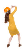 Back view. woman in a dress and protective construction helmet p Stock Photo