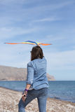 Back view of woman flying kite Stock Photography