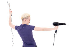 Back view of woman hair stylist posing with hairdryer and curler Stock Photos