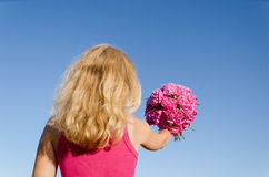 Back view of woman and hand with peony bouquet Royalty Free Stock Photography