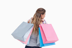 Back view of a woman holding shopping bags Stock Image