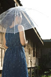 Back view of woman holding umbrella Royalty Free Stock Photo