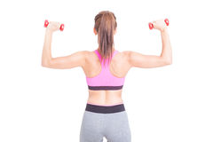 Back view of woman lifting pair of dumbbells Stock Photo