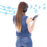 Back view of woman listening music with mobile phone over white Stock Images