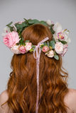 Back view of woman with long hair in flower wreath Royalty Free Stock Photography