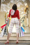 Back View of Woman Looking at Store Royalty Free Stock Photo