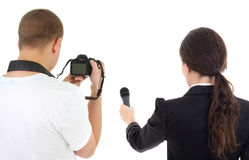Back view of woman with microphone and man with camera isolated Royalty Free Stock Photos