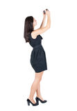 Back view of woman photographing. Royalty Free Stock Photography