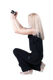 Back view of woman photographing. girl photographer in jeans. Re Stock Photo