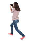 Back view of woman photographing. Royalty Free Stock Photo