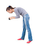 Back view of woman photographing. Royalty Free Stock Image