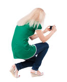 Back view of woman photographing. Royalty Free Stock Images