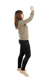 Back view of woman photographing. Stock Image