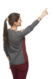 Back view of woman pointing at copy space royalty free stock photography