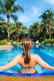 Back view of woman in the pool Stock Photo