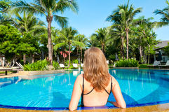 Back view of woman in the pool Royalty Free Stock Images
