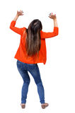 Back view of woman protects hands from what is falling from abo. Ve. woMan holding a heavy load Rear view people collection. backside view of person. Isolated royalty free stock photography