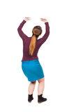 Back view of woman protects hands from what is falling from abo. Ve. Man holding a heavy load Rear view people collection. backside view of person. Isolated over royalty free stock photography