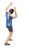 Back view of woman  protects hands from what is falling from abo Royalty Free Stock Photography