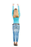 Back view of  woman. Raised his fist up in victory sign.  Teenager is sipped or stretch herself. Rear view people collection.  backside view of person Royalty Free Stock Image