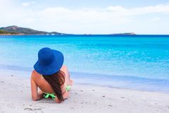 Back view of woman relaxing at tropical beach Royalty Free Stock Images