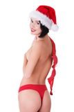 Back view woman with santa hat holding bra Stock Photo
