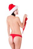 Back view woman with santa hat holding bra Royalty Free Stock Images