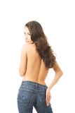 Back view of woman shirtless touching bum Royalty Free Stock Photography