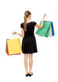 Back view of woman with shopping bags . Stock Photo