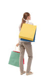 Back view of woman with shopping bags . Royalty Free Stock Images