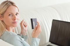 Back view of woman shopping online Royalty Free Stock Image