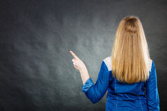 Back view of woman showing copy space. Royalty Free Stock Photo
