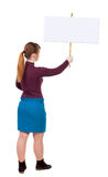 Back view woman showing sign board. Man holds information plate. Rear view people collection. backside view of person. Isolated over white background. Girl in Royalty Free Stock Images