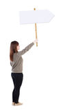 Back view woman showing sign board. royalty free stock photos