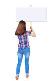 Back view woman showing sign board. Man holds information plate. Rear view people collection. backside view of person. Isolated over white background. Girl in Stock Images