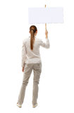 Back view woman showing sign board. Man holds information plate. Rear view people collection. backside view of person. Isolated over white background. A girl Stock Images