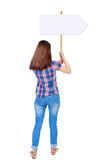 Back view woman showing sign board. Stock Photo